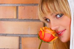 The beautiful girl. The girl with a yellow rose Royalty Free Stock Photo