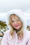 Beautiful girl. A beautiful little girl in winter coat at the snow Stock Photo