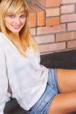 The beautiful girl. The nice girl at a fireplace Stock Photos