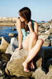 Beautiful girl. On a rocky coast Royalty Free Stock Image