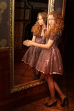 Beautiful girl. In a luxurious interior, the reflection in the mirror Stock Photo