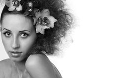 Beautiful girl. Picture of beautiful woman with orchid flower Royalty Free Stock Photo
