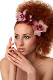 Beautiful girl with. Orchid flower. Isolated Stock Photography