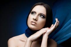 Beautiful girl. The very  pretty woman with  blue  neckerchief, sensual sexuality gaze Stock Image