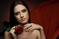 Beautiful girl. The very  pretty woman with red  rose, sensual sexuality gaze Stock Photos