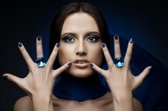 Beautiful girl. The very  pretty woman,  rings with huge blue brilliant, sensual sexuality gaze Stock Photography