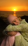 Beautiful girl. Sleeping on a beach at sunset time Royalty Free Stock Image