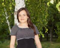 Beautiful girl. Beautiful smiling girl near birch Stock Photography