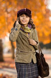 Beautiful girl. Vertical photo, stylish beautiful little girl hold mobile phone and gladness talk royalty free stock photography