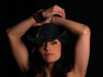 Beautiful girl. Beautiful latino with a hat posing over black Royalty Free Stock Photos