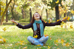 Beautiful girl. Happy girl throwing up autumn leaves Royalty Free Stock Photography