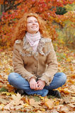 Beautiful girl. Happy girl rests in an autumn park Royalty Free Stock Photos