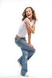 The beautiful girl in daily. The girl in jeans and a white vest Stock Image