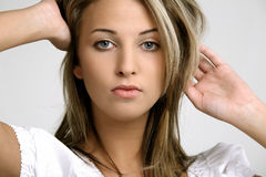 Beautiful girl. Beautiful woman face isolated on white background Stock Photo