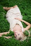 Beautiful Girl. Summer. Portrait of  blonde girl having rest at clover meadow Stock Images
