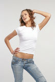 The beautiful girl in daily. The girl in jeans and a white vest Royalty Free Stock Photography