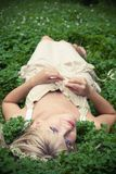 Beautiful Girl. Summer. Portrait of  blonde girl having rest at clover meadow Royalty Free Stock Images