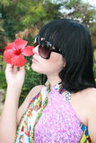 The beautiful girl. Girl the brunette with a flower royalty free stock image