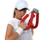 Beautiful girl. Young woman has exercise in gym with expander Stock Photography