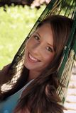Beautiful girl. Beautiful brunette teenager, relaxing in a hammock Stock Photos