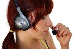 Beautiful girl. Beautiful brunette girl listening music, isolated on white background Royalty Free Stock Photography