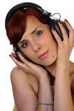 Beautiful girl. Beautiful brunette girl listening music, isolated on white background Royalty Free Stock Images