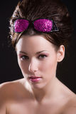 Beautiful girl. With pink sunglasses on her head Stock Photography