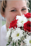 Beautiful girl. Bride with bouquet of flowers smiling Stock Images