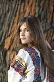 Beautiful girl. Portrait of a Girl in Ukrainian costume for a tree Royalty Free Stock Images