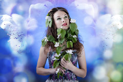 Beautiful girl on abstract flower background with flowers in hai Royalty Free Stock Image