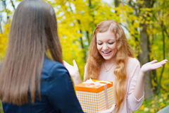 Beautiful girl accepting a gift Royalty Free Stock Photography