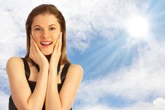 Beautiful girl against the blue sky with clouds Royalty Free Stock Image