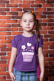 Beautiful girl against the break wall Royalty Free Stock Image