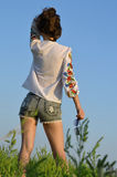 Beautiful girl against the sky. Royalty Free Stock Photo