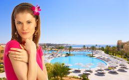 Beautiful girl against tropical resort Royalty Free Stock Photos