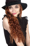 Beautiful girl at age of nineteen in a bkack hat Stock Photos