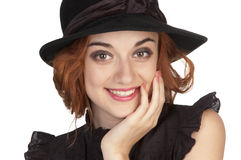 Beautiful girl at age of nineteen in a black hat Stock Images