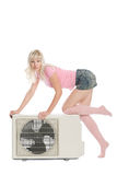 Beautiful girl with the air conditioner Royalty Free Stock Images