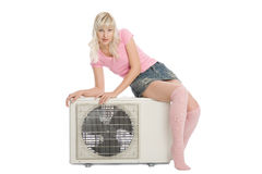 Beautiful girl with the air conditioner. Royalty Free Stock Image
