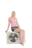 Beautiful girl with the air conditioner. Stock Photos