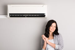 Beautiful girl and air conditioner Stock Photo