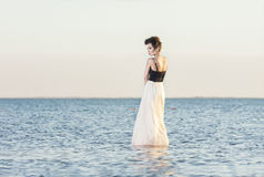 Beautiful girl alone. The beautiful girl costs on among the lake alone Royalty Free Stock Images