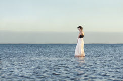 Beautiful girl alone. The beautiful girl costs on among the lake alone Stock Images