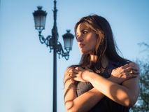 Beautiful girl alone against blue sky Royalty Free Stock Photos
