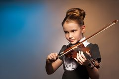 Beautiful girl alone playing on the violin Royalty Free Stock Photos