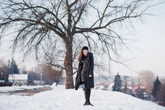 Beautiful girl alone in winter city Stock Photography