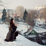 Beautiful girl alone in winter city Stock Image