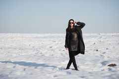 Beautiful girl alone in winter field Royalty Free Stock Photos