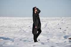 Beautiful girl alone in winter field Stock Images