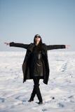 Beautiful girl alone in winter field Stock Image